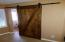 Barn Door to 4th Bedroom, Furnished with Armoire in lieu of Closet