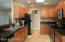 Granite counters, double stainless sink and lots of cabinet space and open view to great room.