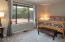 Patio view bedroom with walk-in closet.Spacious guest bedroom with a patio view and a walk-in closet.