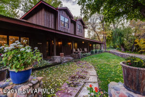 Spectacular 10+ Acre property above the banks of the Oak Creek with over 300 Ft of private creek frontage, mature trees, fruit trees, irrigated grass pasture and so much more. This is your own private oasis. The main house was remodeled in 2015, creating over 3,000 SQ FT. Downstairs are 2 beds, 2 baths, and the main living quarters. Up the custom staircase is a second living area with 2 beds, and 1 bath. All the finishes are of the highest quality. The rough sawn pine exterior carries over to the 2,100+ Sq Ft Garage with an additional 1,475 Sq Ft bonus room above. New drywall is installed. Make this an office, game room, trophy room, hobby room or any other use. There is a deck with views of the pasture off of the upstairs room. This is a 1 of a kind resort like property.