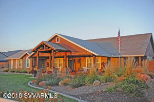 Welcome to Equestrian Estates where the entire community has access to the Verde River. This custom, craftsman, lodge home was completed in 2016. You will be delighted by the Coy pond with a waterfall, covered porches, salt water pool, garage space for 6 vehicles and the thoroughly upgraded home where every attention is to quality and detail. Additional  Features include: Batt rather than blown in insulation.Natural Gas, Electric, Suddenlink and Satellite Dish service. Wiring is 12-2 and 12-3 Block fencing. Plantation shutters are throughout house and garages. Granite countertops and Hickory cabinets are throughout. There is  Central Vac, Potassium Water Softener, Recirculating hot water, 2- AC and 2 Furnaces. It is  Single level with wider doors of handicapped access. See Attachments.