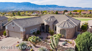 Extraordinary & Stunning! With over a $100,000 in upgrades & finishes, this home delivers. Positioned on a superb lot with outstanding Mingus Mountain and Golf Course Views!  Paver stone walkway leads you through the gated courtyard and into this magnificent home enhanced with travertine tile & crown molding. Chef's kitchen featuring granite counter tops, breakfast bar & nook, large island, double oven & separate dining area with built in buffet. Open great room includes entertainment wall, gas fireplace & wet bar. Opulent master suite consists of two walk-in closets, separate vanities & water closets, soaking tub and large walk in shower.  Huge second master suite with built in murphy bed. Enjoy your resort style backyard year-round with heated pool & spa, water feature and built in BBQ.