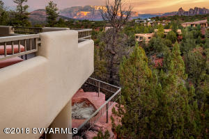 Perfection in the red rocks of Sedona. Top sought location in luxury Sedona community of Mystic Hills. The home was architecturally designed to capture views to North, East, & South by facing all windows/decks to the red rock forms of Elephant Rock, Cathedral & Courthouse rocks. The main level offers wide, expansive & open spaces in the living area with gracious formal dining & separate breakfast dining either side of the well appointed kitchen which opens to the deck. Relish indulgence in a master suite & regal bath w/private water closet/bidet, snail shower, dual vanities on stone counters & elevated tub for red rock viewing wonder. A wide stairway escorts guests to additional bedroom suites, custom glass wine cabinet, a media room accessing the outdoor deck & hot tub. Exquisite.