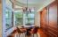 Breaksfast nook with knotty cherry inset cabinetry/