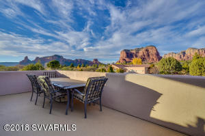 Step outside the billiards/ media room to this amazing open air deck to breathe in the views!
