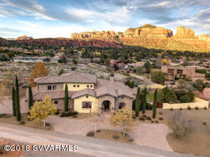 Elegant Tuscan style home with stunning Sedona Red Rocks views. Great for entertaining family & friends. Gourmet kitchen and top-of-the-line appliances, including walk-in freezer and pantry, formal dining room with wine bar, and a separate breakfast nook. Great room, connected to kitchen by a wet bar, has cathedral ceilings with wood beams and a gas fireplace.  Fully-enclosed and landscaped backyard has a covered patio with outdoor heating and fan for year-round enjoyment, along with a pool, spa, and BBQ area on almost an acre. What more can you ask for in a home? How about an office/den which overlooks backyard pool and views. Four bedrooms, two located on ground floor; upstairs master bedroom with his and hers walk-in closets, whirlpool tub and separate shower with multiple shower-heads.