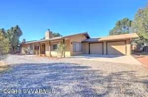 Great location in the heart of West Sedona,  within walking distance to shops, restaurants & movie theater.  This well maintained home is ready & waiting!  The great room style floor plan with views & a cozy wood burning fireplace. There is a large Arizona room which can be accessed from the dining room, kitchen & master bedroom.  Kitchen has natural gas range & oven, built-in microwave. The 2 car garage has separate bays, circular driveway & fenced backyard. Home has new roof & new oversized gutters in Oct., Arizona room has new flooring in Nov. Included is a 1 year home warranty.