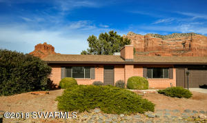 Location, Location, Location!!! This 2 bedroom, 2 bathroom home is nestled at the base of Bell Rock, one of Sedona's most stunning landmarks.  This property just received many updates! All new kitchen and bathroom cabinets, counter tops, appliances, and paint with new flooring throughout. This property is perfect for a quick weekend get away or a cozy place to call home everyday! Backing to forest service land you will enjoy amazing red rock views and quick access to endless hiking trails. Hurry and schedule your showing today!