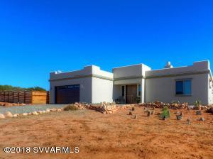 Do you want to get away from it all, yet have the luxuries of a modern home? Are privacy and endless views your ideal setting?  Then look no further than this 2 bed 2 bath custom home on 2 acres that borders the national forest. Built in 2017, this custom home features incredible views, travertine tile floors, tall ceilings, quartz countertops, and alder cabinets, covered patio, fenced garden and a private well. This barely lived in home is ready to move into. Get away from it all...in style!