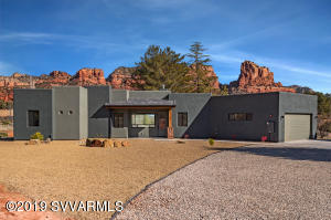 Brand new home completed January 2019!  Completed & ready to move into! Big view windows in a single level Santa Fe design home with upscale finishes of glass tile, stainless appliances, solid stone counters & plank floors. Large covered back patio looks directly onto a horizon of red rock formations. Gorgeous views on an acre of land in the coveted, no back up traffic area, the Village of Oak Creek. Room to build an attached casita or put RV in an extra garage. Just 2 hours to Phoenix Sky Harbor airport, 5 miles to Uptown Sedona, 50 min to mountain Skiing in Flagstaff and very near to excellent hiking/biking trails,  restaurants, resort hotels, fitness clubs & shops.