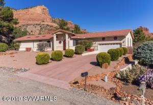 Close-up red rock views, including views of Castle Rock, Courthouse Rock and Bell Rock. New roof, floors, paint and appliances in 2017. Peaceful location, yet close to all VOC has to offer, including hiking and biking. Walk to shopping, restaurants, coffee, health clubs, and more. Main living all on one level with open-concept kitchen/dining/living/great room. Large master bedroom. Master bath with jetted tub, walk-in shower & walk-in closet. Main level also features 2 more bedrooms, full bath, laundry room & half bath. The rear deck, accessible by sliding doors from living area and French doors from master bedroom, offers sweeping natural light and serene outdoor living. The basement includes, full bath, living/rec room area and 2 more possible bedrooms. Seller is a licensed Realtor - CA.