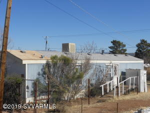 Wide open views of Mingus Mountain and the Redrocks. Located at the end of a cul-de-sac. No HOA dues on a large lot.  City water and sewer. Laundry room and Breakfast Bar.  Single wide with a split floor plan. One bedroom has had the carpet removed and the home needs TLC. Come and see what you can buy for under $90,000.