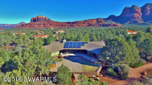 As the first home built in the coveted, gated community of Highland Estates, advantage was taken of a prime homesite, offering exceptional serenity, privacy, and glorious 330 DEGREE RED ROCK VIEWS! This spacious, gracious Sedona Rancher is ideally situated at the end of a cul-de-sac on a wooded acre, bordering NFS land. The open, naturally flowing floor plan and walls of windows inspire serenity, and invite the outside in. Each of the three bedrooms are generously sized and include their own bathrooms, walk-in closets, and Red Rock views. The kitchen features granite countertops, stainless steel appliances, a gas cooktop, two ovens, and a movable island. A circular driveway leads to the oversized garage, which offers a wide variety of car park, workspace, and storage options.