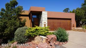 ***LOCATION, BREATHTAKING VIEWS AND MODERN STYLE!!***This Elegant European style 3 bed, 2.5 bath home is in West Sedona, close to hiking trails and the local vibe yet on a very quiet private street.  Astounding views of Thunder Mountain, Munds, Mogollon Rim, The Cockscomb, Cathedral Rock and Airport Mesa.As you enter this stunning one of a kind split level home you will be greeted by spectacular walls of quartzite stone, artistic earth tone venetian plaster and beautiful hardwood brazilian cherry floors.  The open floor plan and walls of glass create a light and bright living space, designed to embrace the outdoors.  The house features a generous bold colored galley kitchen with recessed lighting,  modern stainless steel appliances, five burner gas stove top, caesarstone counter tops