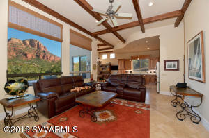 Perfectly designed sitting elevated on the lot to capture the stunning Red Rock Views. This custom home offers walls of glass and high ceilings to take in the panoramic views. Over $100,000 in improvements!  Superior finishes throughout including beautiful travertine floors, wood beams, sandstone pillars, upgraded light fixtures, new window treatments , two gas fireplaces and so much more!  Complete remodel on kitchen including brand new appliances, Quartz counters and hickory cabinetry. Master suite includes two sided gas fireplace, stunning soaking tub, new shower, and hammered copper sinks .  Large walk in closet.  Complete remodel on guest bathroom including lots of storage.  Outdoor living on back patio  with water feature, fireplace, built in New BBQ grill and room to relax.  A full