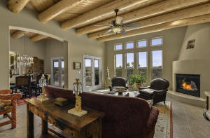 Fabulous living room with fireplace with cathedral ceilings & views!