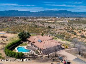 Remarkable views and amenities await you on this stunning four-acre horse property. Home has lovely appointments inside and out.Take in the panoramic views from the large picture windows that capture the Red Rocks of Sedona.10- foot ceilings enhance the impressive stone fireplace in the Great Room. Kitchen boasts granite counters,Walnut finish custom cabinets,a coffee bar,and top of the line GE appliances. A generous private master suite awaits you and includes whirlpool tub, large walk-in closet and his and hers vanities Two-car garage has a of storage and room. Driveway and path to front of the home has beautiful brick pavers. Formal yard has grass in the back and xeriscaping in front. Outside features include a lovely covered patio, pool and a 5 person above ground hot-tub.