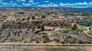 3.25 Acres with Fabulous Unbelievable Forever Views. End of the Road Privacy. Spacious 3 Bedroom 2 Bath Home with Den. Den can be used as 4th Bedroom, without closet. Huge Country Kitchen with Breakfast Bar. Granite Counter Tops. Split Floor Plan. Central  Air Conditioning and Propane Furnace. Laundry Room with Utility Sink. 4752 Total Footage Under Roof Including Wrap Around Patios. Great Outdoor Living year round. Back covered patio can be a 4 car Tandem Carport, or private fenced in area.  Additional 2 Car Carport on side of home. Home is on a Concrete Stem Wall. Private Well.  Additional septic tank can be used for building another Home or Shop. New Roof and Flooring throughout in 2017. New light fixtures, master bathtub, toilet, painting inside and outside. Bring up to 6 Horses Allowe