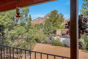 Welcome to serenity with this charming two-bedroom, two-bathroom home located on a quiet cul-de-sac In Sedona. The home has a blend of both nature and neighborhood living with mature trees that form spectacular curb appeal. The backyard features views of Capital Butte and Coffee Pot Rock directly from the covered balcony. The ample living room offers windows overlooking the balcony that provide great lighting. Enjoy quiet nights around the fireplace that serves as the focal point of the living room. The home boasts plenty of privacy and views of the red rocks.