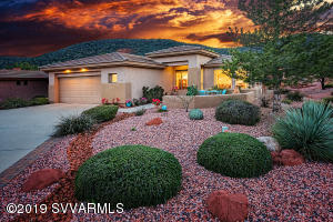 Spectacular sunset view from the front elevation of this golf course community home.