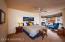 Enormous Master Suite boasts cozy bay window reading nook seating area.