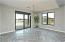 with Brushed Nickle Dining Light, Sunny Sliding Door & Side Window, Beautiful Lake Views, 2 Tone Paint & Herringbone Plank Tile Flooring.