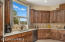 Granite counter tops, stainless steel appliances, solid alder soft close cabinetry
