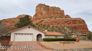 Great Southwest home with tile roof that sits on a slight knoll with views of Castle Rock in the back & views of Nat Forest from front patio. Very quiet neighborhood. Less than a 5 minute drive to Bell rock & fabulous hiking trails!Split bedroom with high ceilings in liv rm + fireplace to take in the natural light & view Castle Rock. 2 car attached gar. NO STEPS. Well built 1989 home that needs some updating in kitchen & bathrooms. 3 years new washer dryer refrig included.