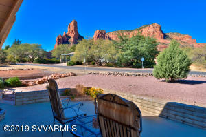 Here is your perfect Sedona Get-Away-Home! It has been lovingly remodeled with new Travertine flooring, Granite countertops, Stainless Steel appliances, tile and paint. Step out on the patio to be joyfully stunned at the majestic red rock beauty! There are 2 master suites and each one has 2 closets and a new bathroom with granite and travertine. One bath has a huge soaking tub and the other a massive walk-in shower. The landscaping is low maintenance and there is a new roof too! It is in Move-In condition and is ready for you! The bright kitchen is very sleek and has plenty of counter space and many cabinets for storage. The wood beamed ceiling and custom limestone fireplace are the architectural focal points of the living room which make it comfortable and cozy.