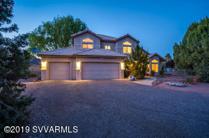 Welcome to 135 Vista Mesa Drive. 5 / 3.5 bth on .83 Acres offering red rock views, upgraded kitchen and baths, and 3 car garage...WELCOME HOME!