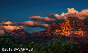 Striking sunset glow on red rock formations, photo taken from this level view lot.