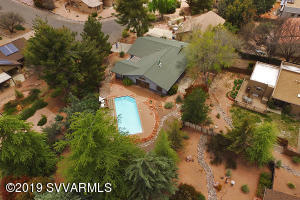 Pool weather is here. This one is heated!. Come have a look at this amazing home with views of Courthouse and Lee Mountain. The great room has a fireplace. There is granite in the kitchen.Bedrooms are spacious and comfortable.  Popular trails heads are close by. Or, just stay home and relax by the pool!