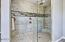 Large Clear Glass & Full Tiled Step-In Shower w/Dual Valve & Rainhead + Bench.