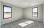 with Sunny Front Windows, Plush Carpet Flooring, Ceiling Light, Walk In Closet & En Suite Bath.