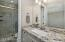 with Clear Glass Full Tiled Step-In Shower, Executive Height Granite Vanity, Brushed Nickle Lights & Fixtures, Handles & Pulls, Plank Tiled Flooring & Dual Top Flush Comfort Height Toilet.