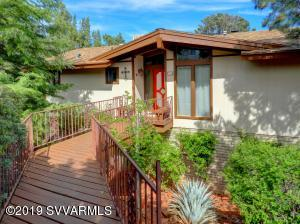 Enter the main living area via an elevated bridge overlooking an awesome agave grove