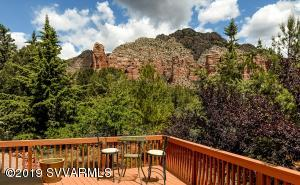 Quaint Sedona retreat with successful VRBO history has everything you need! Nestled in mature trees that shelter birds & wildlife. Majestic views of Rabbit Ears and Lee Mountain will take your breath away. Home has recently been remodeled with new Italian tile floors, granite countertops, new appliances and updated bathrooms. Light and airy feel with glass sliders to the outdoors from every room. Enjoy relaxing on the large deck with beautiful, unobstructed Red Rock views or enjoying a meal under another large covered deck. This area boasts the darkest skies in Sedona and has easy access to trails. A Zen-Spa master bathroom offers walk-in rain shower with decorative mosaic tiles. The home even has a basement!  Guest quarters with separate entrance is a perfect retreat, studio, or office.