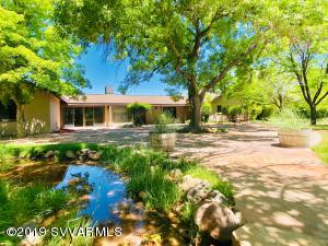 Here is your chance to own one of Cottonwood's most unique riverfront greenbelt properties. This 3750 sq ft ranch home sits on 4.49 irrigated acres with a personal pond and an untouched forest on the Verde River. Surround yourself with lush greenery and trickling water. The house has been recently updated, including new fixtures, new paint inside and out, new flooring, and more! This property is very private and rural, yet just a 2 minute drive to the grocery store and less than 3 miles to Old Town Cottonwood. Potential vineyard property with plans available.