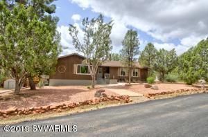Vacation rental history available. A light & airy home in popular west Sedona. This home features 3 bedrooms, large game room/office, formal dining rm, eat in kitchen, w/gas stove. The living room is an open concept living room with wood burning fireplace. Living room walk out to a covered deck, overlooking the mature trees in privacy. Two car garage & paver driveway. RV Parking in adjacent driveway on the other side of the home. Seller is a licensed RE agent in Arizona.
