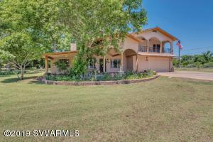 Come home to the country! Located in highly desirable Ft Lincoln Estates with ditch irrigation and across the street from the Verde River. This home is on a lovely corner lot with pecan trees, various fruit trees, country irises & grass. Property is perimeter fenced & cross fenced. Nice view of the Verde River from your private master suite balcony. Original home was rebuilt with precision and a master suite addition was added by builder in 2005. Due to original slab/walls, county shows effective age of 1975. All new top of the line electrical & plumbing throughout, no rock was left unturned... Only the best materials were used. Tremendous attention to detail.  Home priced well below replacement cost.. Come and see for yourself!