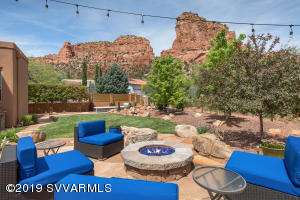 Luxurious, single level, 2,854 SqFt home, (3) bedroom, in Sedona's Village of Oak Creek, offering enchanting red rock views! This home is designer-influenced soft contemporary style featuring over $225,000 in NEW interior remodel renovations. NEW Zen outdoor living spaces with a resort-style ambiance. Beautiful outdoor landscape design with new designer planter boxes for organic gardening; new water feature; new gas fire-pit; premium 5-burner built-in BBQ grill; newer $50,000+ 'Endless Pool Fitness System' + hydraulically powered underwater treadmill creating your own at-home wellness system; new hand fabricated stylish dog run fencing accommodating small or large pets. Bonus roof-top deck to enjoy the exquisite sunrises, sunsets and gorgeous starry nights. Two-Car over-sized garage...
