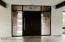 Large custom pivot front entry door.