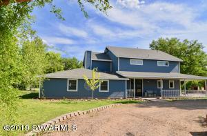 Live on historic, scenic Pecan Lane in the Camp Verde Green Belt! This beautiful, rustic yet modern farmhouse is filled with gorgeous luxury! Located on 1.25 acres of lush irrigated land surrounded by shade trees you will think you're in the south, not the southwest! This slice of heaven features a spacious home spilling w/ farmhouse finishes, wood flooring, claw foot tub, vessel sinks, stacked stone fireplace, historic wood salvaged barn door shutters & so much more! A beautiful master suite offers a private retreat with patio access, and large, stunning bath. Additional 3 guest bedrooms plus enormous loft family/game room, spacious living room with fireplace, office and modern kitchen with huge breakfast bar island and dining w/ picture windows featuring mountain views...More