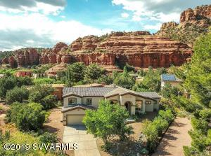 Beautifully encompassed by Red Rock views, this tranquil cul-de-sac is a perfect retreat!