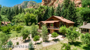 Enjoy the splendor of this wonderful Oak Creek Canyon estate! Built in 2014 &resting in the gated community of Junipine Estates; with over 1/2 mile of creek frontage, acres of orchards and the historical Purtyman cabin. Inspiring design has been brought to fruition w/ meticulous attention to detail. Offering the rare opportunity to enjoy the spectacular scenery and peaceful serenity of creekfront living in Oak Creek Canyon's finest neighborhood.  Relax on the rolling lawns, decks & patios to the serenade of the cascading waters of Oak Creek. Upscale appointments & the finest finishes throughout; gourmet chef's kitchen, soaring ceilings, dramatic view windows, & professional decor. Stunning red rock, mountain, forest & creek views! Just minutes from town, yet worlds away from the ordinary