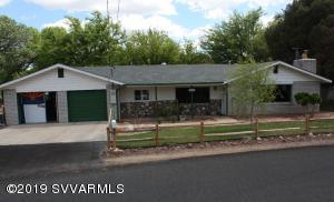 The GARAGE and MAN CAVE is the star of this home, over 1340 Sq.Ft. (52x26approx). Nearly everything has been replaced in this home, in the past year. You will love this rural location, Snuggled in the trees, near Beaver Creek, Private water well keeps the grass green without a huge water expense. Home backs up to Russel Wash, so no homes directly behind you. The courtyard with 'sail-shade' extends the living area of this home. Living room has wood burning brick fireplace, new carpet and remote ceiling fan. Master bedroom with huge walk-in closet, private bath and double french doors to Courtyard. Second bedroom has a murphy bed which adds to the rooms functionality. Extra storage in laundry room, and kitchen pantry is a great feature. Attachement will list more features of this home.