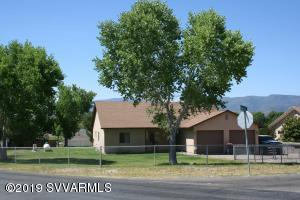 Wonderful 1731 square foot home on .45 of an acre, 4 bedrooms, split floor plan, open concept living space.  Breakfast bar, kitchen/dining space large laundry room and pellet stove in the living room to keep everyone cozy warm during those cooler days!  Master site has generous soaking tub, separate shower, dual sinks and spacious walk in closet.  Fourth bedroom currently being used for storage.  Over sized 636' garage with 8 foot tall garage doors, double gates with additional gate and parking for your R/V or extra toys!  This property also has its own water well!!  You have the availability to use the private water company for your water use or your own water well!  Covered back porch with backyard views and your yard is fully fenced!