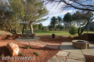 Full view of golf course from Living, Dining, Primary Master Suite & Kitchen. Recently remodeled. Two suites plus a guest bedroom. ''Over the top'' back yard with built in bbq, water features, fire pit & shade trees. Two car garage with storage. Near good restaurants & coffee houses. Stone's throw to Village of Oak Creek Assoc. clubhouse, park & tennis courts. Furniture package possible on separate bill of sale.