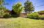 Lush backyard, garden, storage shed