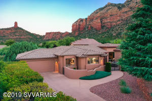 Enjoy breathtaking morning & evening unobstructed Red Rock Views of Thunder Mountain, Chimney Rock, to name a few from within the comfort of your home or while relaxing on one of your 2 viewing decks or your courtyard patio. Borders National Forest allowing access to hundreds of miles of hiking & biking trails and thousands of acres of forest. Single level home with extensive outdoor living spaces to enjoy nature while watching the local wildlife. No HOA, short term rentals, VRBO, & Airbnb a possibility. Centrally located in West Sedona on a Cul-De-Sac in a quiet neighborhood. Upgrades include travertine stone tile floors, stacked stone fireplace, custom designed stained glass windows, water fountain in courtyard, and electronically controlled blackout blinds and outdoor shades.